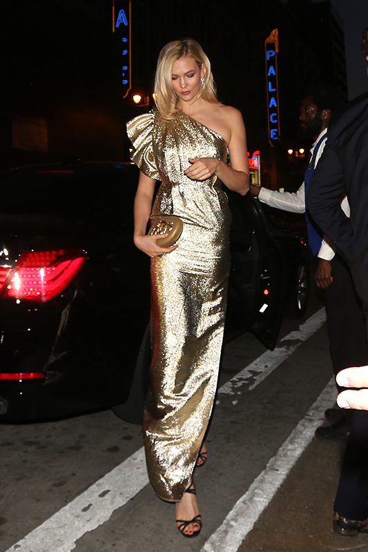 Karlie Kloss wears a shimmering gold dress as she and a male companion arrive to a party held for Gwyneth Paltrow and Brad Falchuck which is rumored to be their wedding in Los Angeles Pictured: Karlie Kloss Ref: SPL1682948  140418   Picture by: Photographer Group / Splash News Splash News and Pictures Los Angeles:310-821-2666 New York:212-619-2666 London:870-934-2666 photodesk@splashnews.com