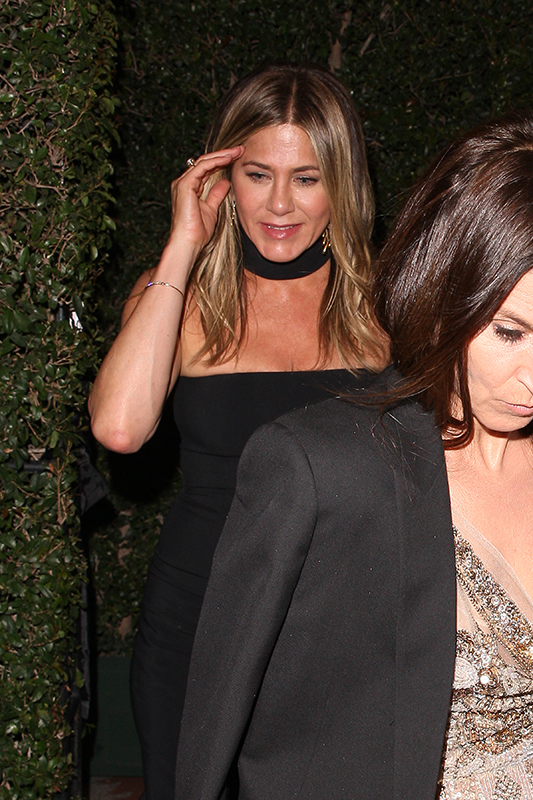 Jennifer Aniston is seen leaving Gwyneth Paltrow and Brad Falchuck's party in Los Angeles Pictured: Jennifer Aniston Ref: SPL1683028  150418   Picture by: Photographer Group / Splash News Splash News and Pictures Los Angeles:310-821-2666 New York:212-619-2666 London:870-934-2666 photodesk@splashnews.com