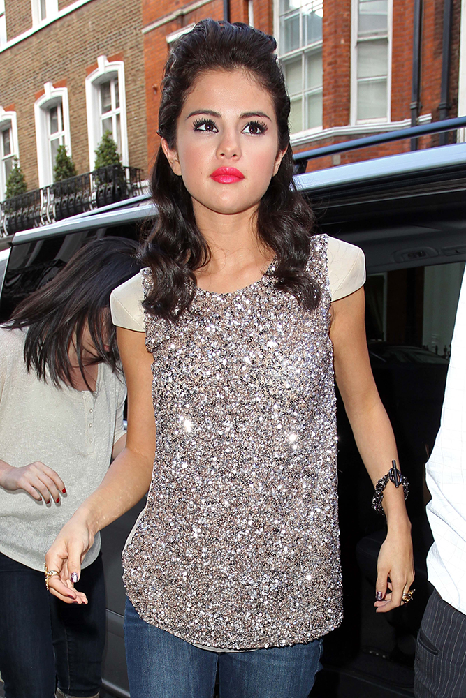 Singer and actress Selena Gomez taking time out of promoting her new album 'When The Sun Goes Down' by doing a spot of shopping near Oxford Street in London. Justin Bieber's girlfriend paid a visit to the 'All Saints' store on Portland Street and bought a few outfits and posed for some fans inside the store.  Afterward, Selena went to a restaurant for some dinner before returning back to her hotel where she spent some time with the fans outside the hotel. Pictured: Selena Gomez Ref: SPL295290  060711   Picture by: Ian Lawrence / Splash News Splash News and Pictures Los Angeles:310-821-2666 New York:212-619-2666 London:870-934-2666 photodesk@splashnews.com