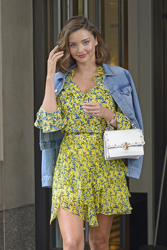 Miranda Kerr wears a yellow floral dress accented with denim jacket as she heads out of her hotel to go to Sephora Times Square for a meet and greet in New York City, New York, USA.  Pictured: Miranda Kerr Ref: SPL1579354  150917   Picture by: Edward Opi / Splash News Splash News and Pictures Los Angeles:310-821-2666 New York:212-619-2666 London:870-934-2666 photodesk@splashnews.com