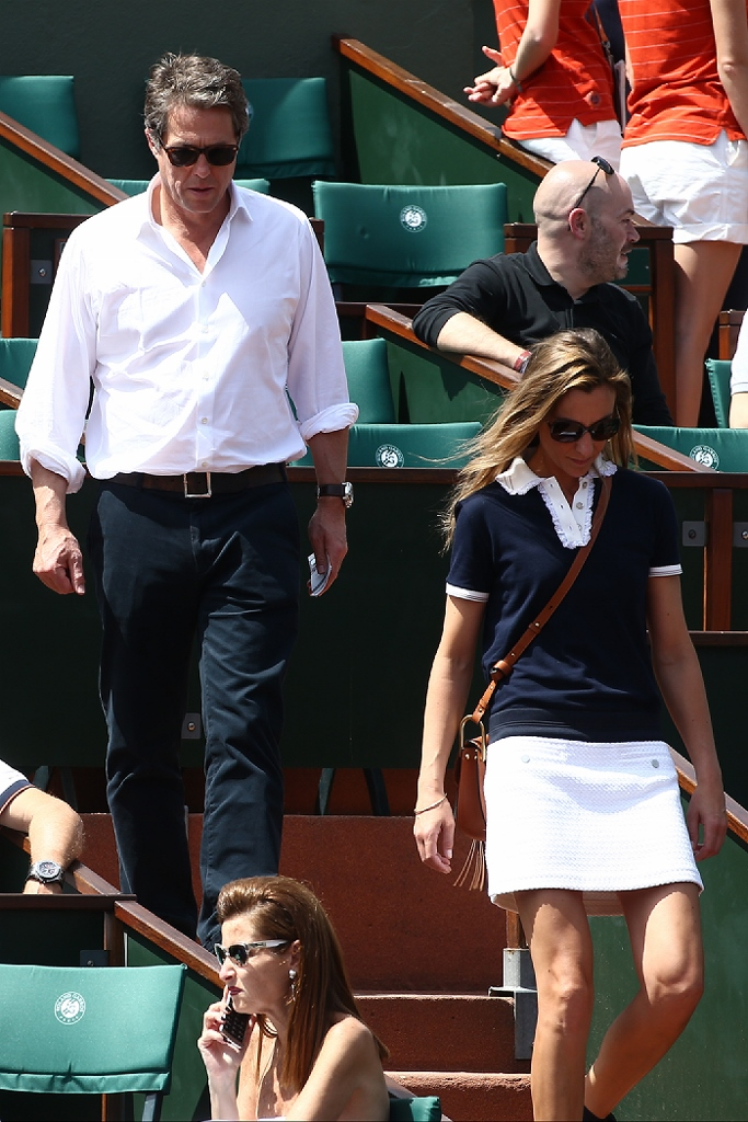 Hugh Grant and Anna Eberstein attend the 2017 French Tennis Open at Roland Garros on June 8, 2017 in Paris, France.  Pictured: Hugh Grant and Anna Eberstein  Ref: SPL1515535  080617   Picture by: Splash News Splash News and Pictures Los Angeles:310-821-2666 New York:212-619-2666 London:870-934-2666 photodesk@splashnews.com