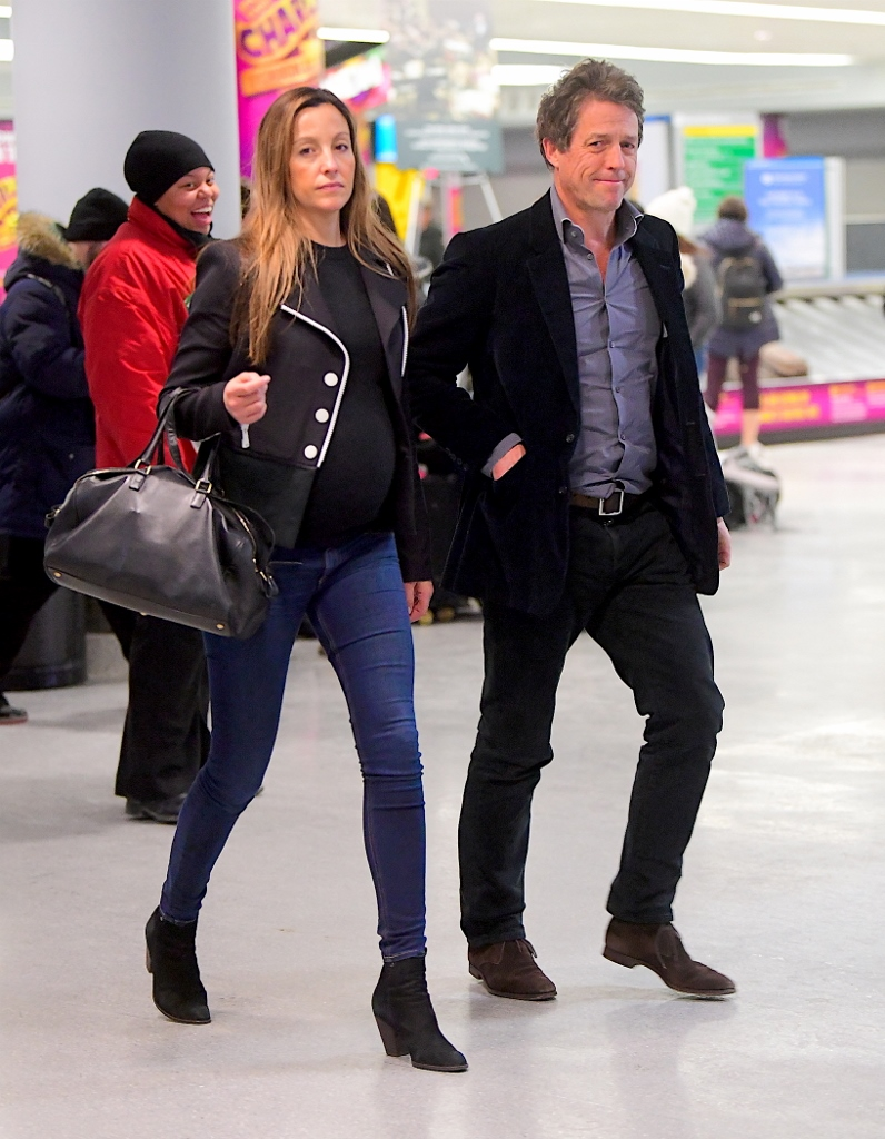 EXCLUSIVE: Hugh Grant was spotted touching down in NYC alongside his pregnant girlfriend, Anna Eberstein. The couple attended the Golden Globes on Sunday in a rare public outing , but as they landed back in the Big Apple, Hugh committed a major fashion faux pas, as he recycled the same exact outfit he wore to dinner 2 days before in LA. He appeared disheveled and tired as they walked through the terminal . Pictured: Hugh Grant, Anna Eberstein Ref: SPL1643862  080118   EXCLUSIVE Picture by: 247PAPS.TV / Splash News Splash News and Pictures Los Angeles:310-821-2666 New York:212-619-2666 London:870-934-2666 photodesk@splashnews.com