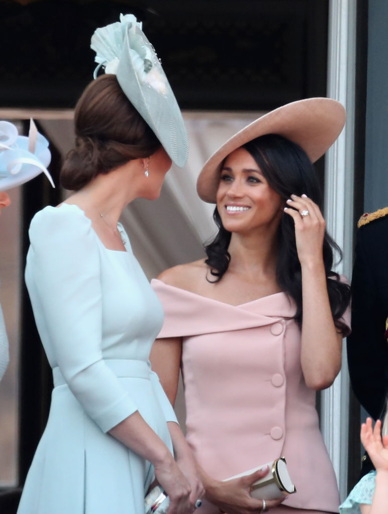 LONDON, ENGLAND - JUNE 09:  Meghan, Duchess of Sussex and Catherine, Duchess of Cambridge watch the flypast on the balcony of Buckingham Palace during Trooping The Colour on June 9, 2018 in London, England. The annual ceremony involving over 1400 guardsmen and cavalry, is believed to have first been performed during the reign of King Charles II. The parade marks the official birthday of the Sovereign, even though the Queen's actual birthday is on April 21st.  (Photo by Chris Jackson/Getty Images)