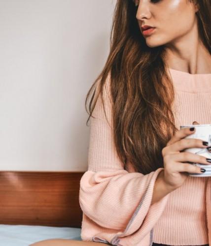 woman holding cup skincare