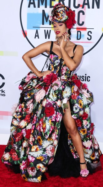 LOS ANGELES, CA, USA - OCTOBER 09: Cardi B (Belcalis Marlenis Almanzar) wearing a Dolce and Gabbana dress (styled by Kollin Carter) arrives at the 2018 American Music Awards held at the Microsoft Theatre L.A. Live on October 9, 2018 in Los Angeles, California, United States. (Photo by Xavier Collin/Image Press Agency/Splash News) Pictured: Cardi B,Belcalis Marlenis Almanzar Ref: SPL5032422 091018 NON-EXCLUSIVE Picture by: Xavier Collin/Image Press Agency/Splash News / SplashNews.com Splash News and Pictures Los Angeles: 310-821-2666 New York: 212-619-2666 London: 0207 644 7656 Milan: +39 02 4399 8577 Sydney: +61 02 9240 7700 photodesk@splashnews.com World Rights